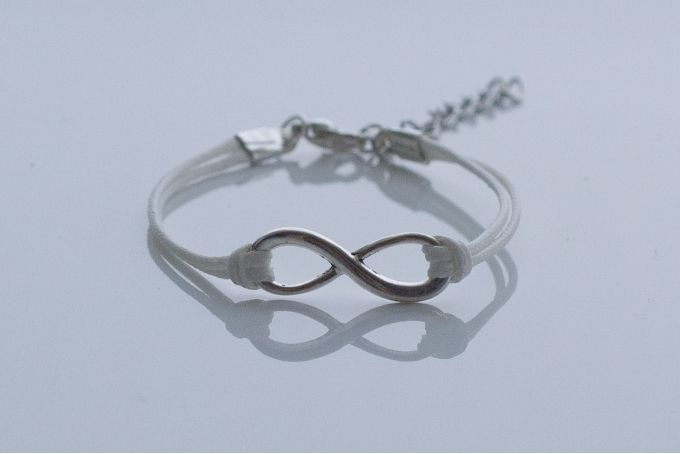 White cord infinity bracelet by Haute and Tidy on hellopretty.co.za