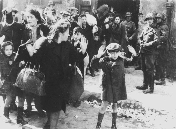One of the most famous photos taken during the Holocaust shows Jewish families arrested by Nazis during the destruction of the Warsaw Ghetto in Poland, and sent to be gassed at Treblinka extermination camp. This picture and over 50 others were taken by the Nazis to chronicle the successful destruction of the Ghetto.