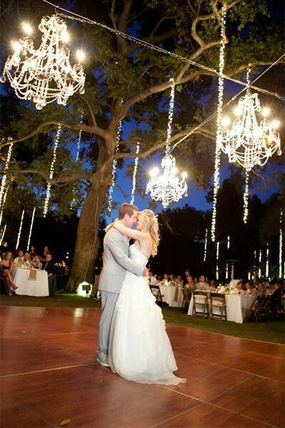 Chandeliers at outside at night under a tree