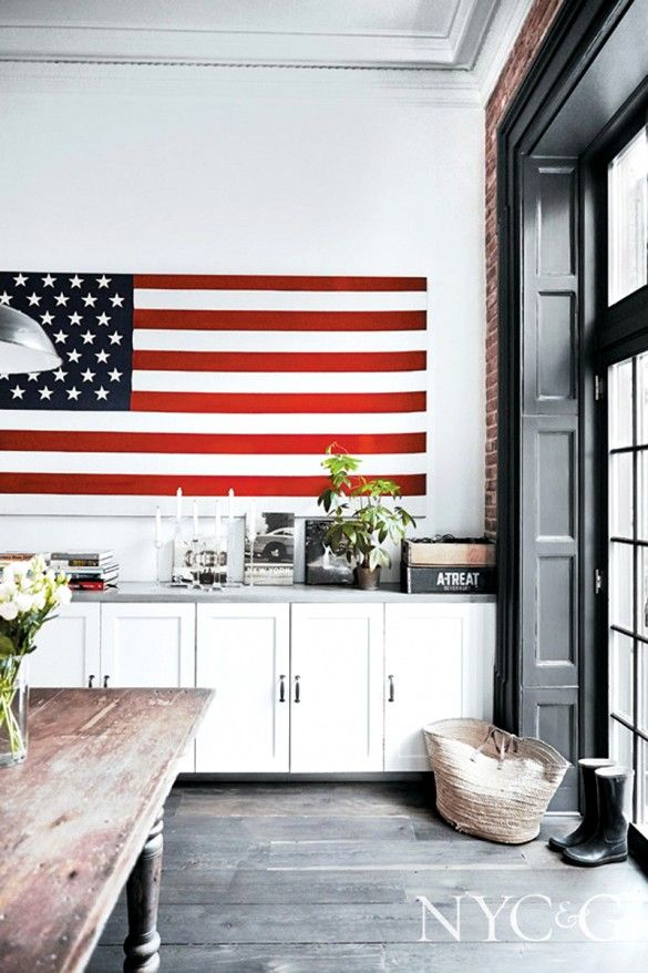 Giant American flag as décor in white kitchen