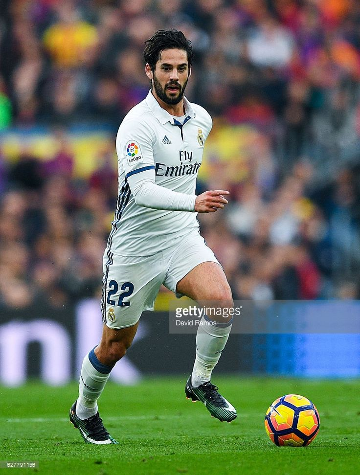 Isco Alarcon of Real Madrid CF runs with the ball during the La Liga match between FC Barcelona and Real Madrid CF at Camp Nou stadium on December 3, 2016 in Barcelona, Spain.