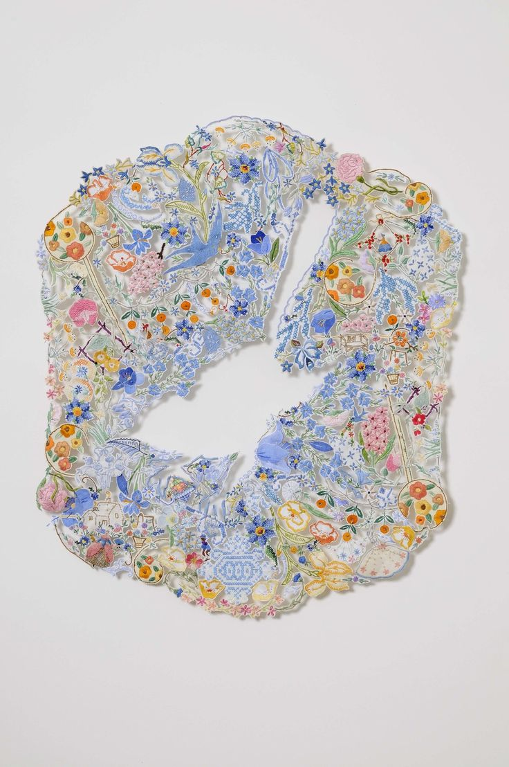 Louise Saxton ~ Blue Wren 2009 ~ Reclaimed needlework, lace pins, nylon tulle, 64 x 54 cm