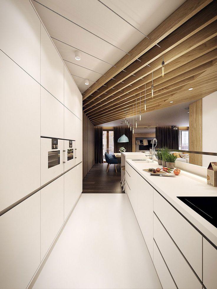 Cucina moderna bianca lucida con grande piano di lavoro estremamente pratico e funzionale