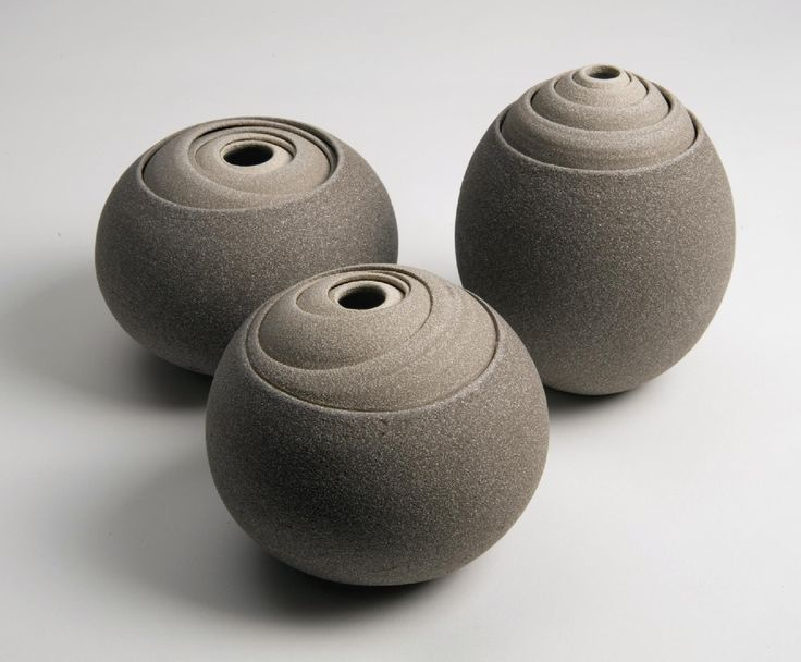 Matthew Chambers is an English potter who lives on an island in England. He studied ceramics at the Royal College of Art and graduated in 2004. His works were born of a love for geometric shapes and constructivists, combined with the earthy tones of the ceramic. Each piece is constructed from multiple concentric layers that form circular objects.