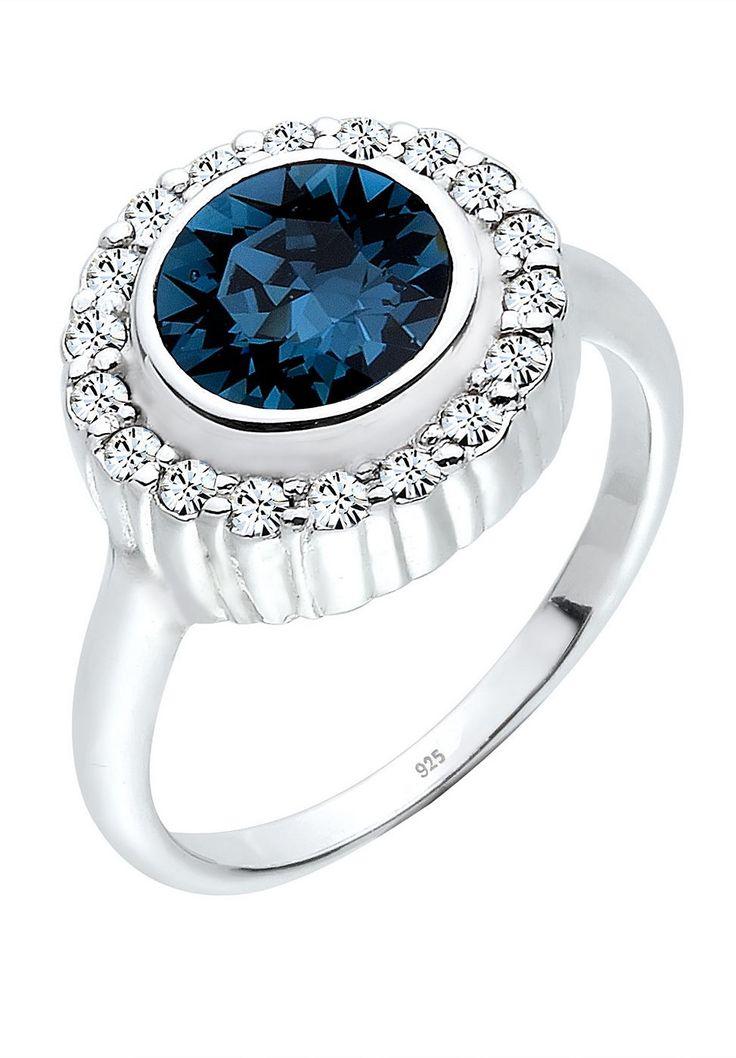 """Glamourös funkeln die atemberaubenden Kristalle von Swarovski auf dem feinen Ring aus Sterling Silber. Ein Kranz aus 18 extravaganten Kristallen umfasst einen eleganten Stein und schmückt extravagant jede Bewegung. Die klassisch modische Form macht diesen Ring zu einem hervorragenden Geschenk für die Liebste. Weitere Hilfe zur Ringgröße: Angegebene Größe in mm entspricht """"Ring Innen-Umfang"""", ..."""