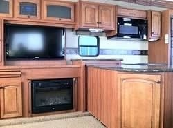2012 Used Heartland Big Country 3450TS Fifth Wheel in California CA.Recreational Vehicle, rv, I have a very nice heartland RV it has been meticulously maintained and cared for, it is a one owner and has been pulled one time and then parked. It is a 2012 triple slide camper and has two very nice flat screen TV's, all leather furniture, cherry wood cabinets, has a built in vacuum inside and also a port outside, ceiling fan, fantastic fan with rain sensor, sofa folds out into a queen size…