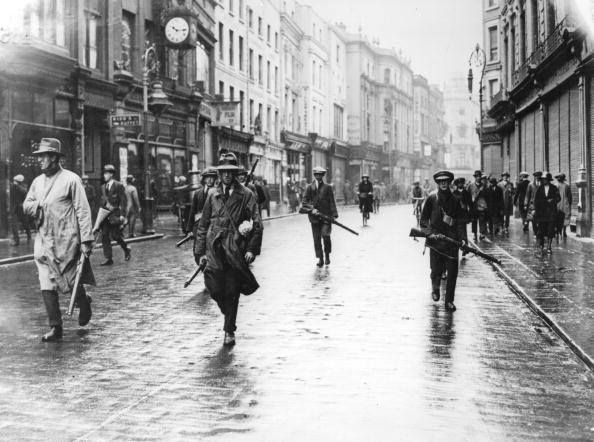Dublin 1922 Armed anti-Treaty members of the Irish Republican Army (IRA) in Grafton Street, Dublin during the Irish Civil War. (Photo by Walshe/Getty Images) Notice how the shop fronts are down, was it Sunday?