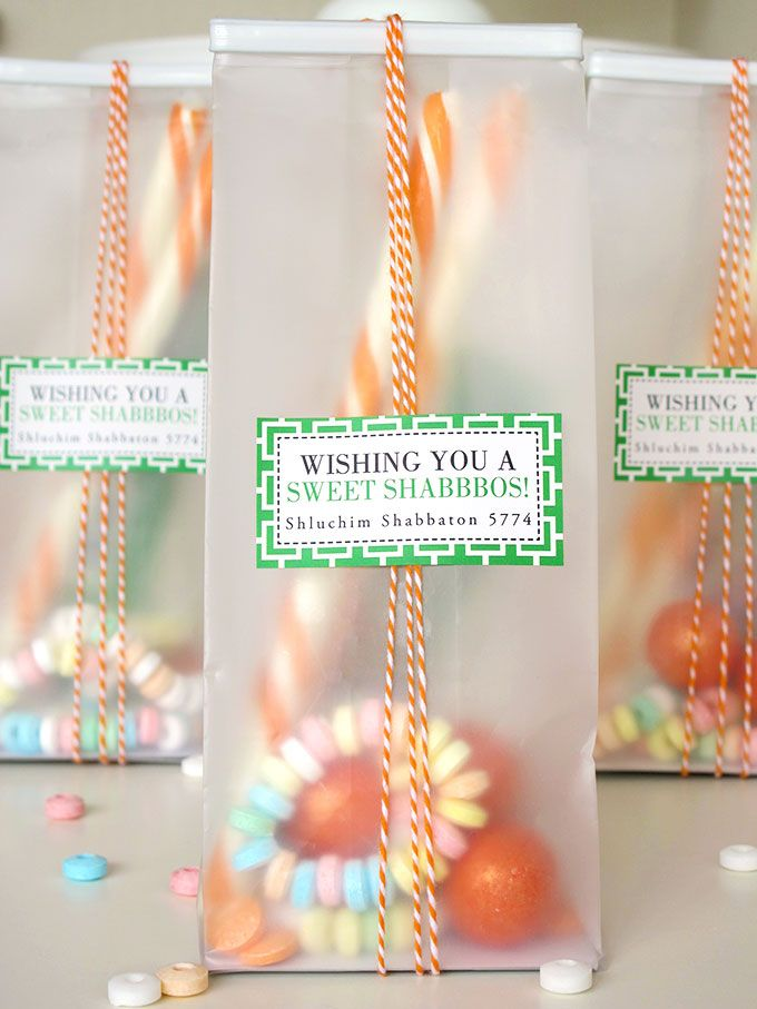 DIY Translucent Tin-Tie Candy Bags with personalized Royal Suite labels.