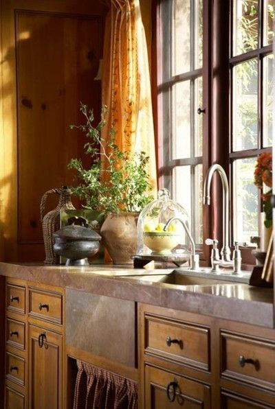 There's something very appealing in this photo - the warmth of light from the widow, the beautiful sink, the comfort of home.