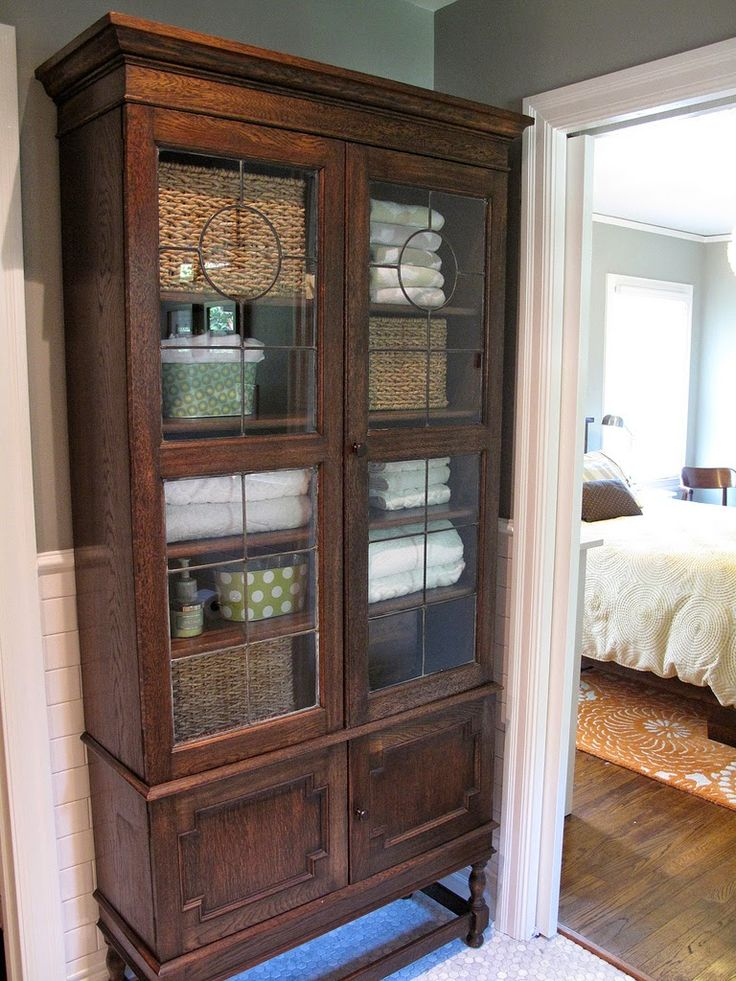6036 best cozy cottage baths images on pinterest for Bathroom armoire cabinets