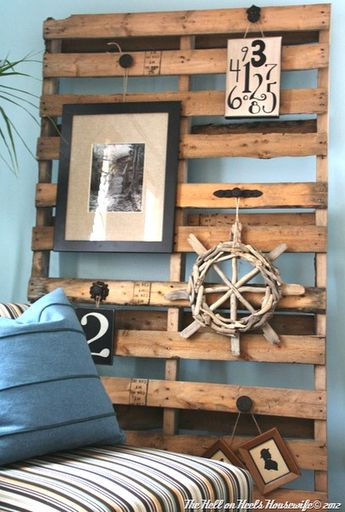 This Pallet Board simply leans against the wall and serves as a display board. Knobs and handles were attached, and a lovely driftwood wheel is in the mix!