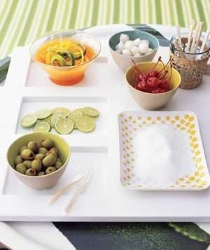 DIY garnish bar: Lay out all the extras?olives, citrus slices, cherries, and cocktail onions, plus sugar or salt on a plate to rim glasses.