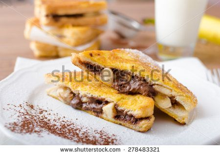 French toast stuffed with chocolate and banana, fresh milk, clean composition