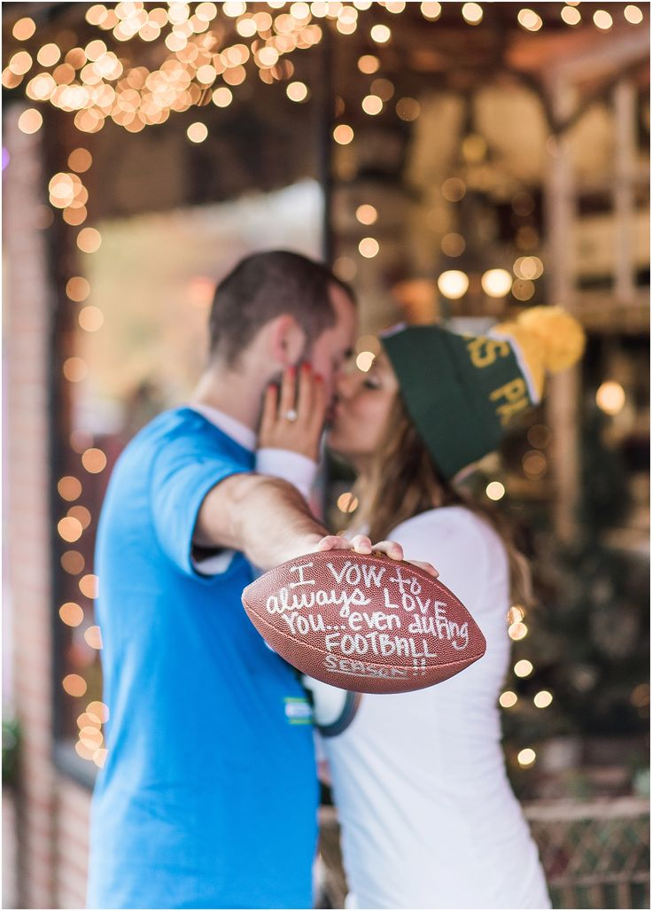 Seahawks packers rival football couple. Football fan engagement photos. Downtown Historic Snohomish Rainy Fall Winter fall engagement photos. Snohomish wedding photographer.