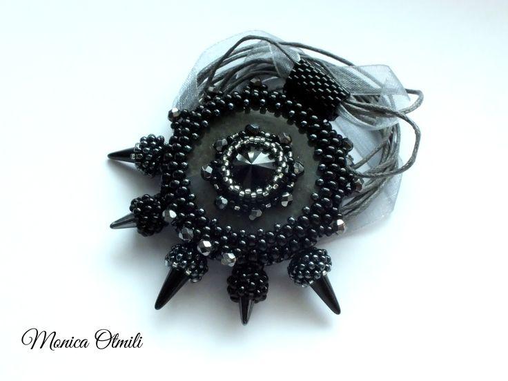 'Myrkur' pendant by Monica Otmili  #black #metalic #beaded #beadwork #pendant #jewelry #necklace #swarovski #blackmetal #metal #myrkur #music #spiky