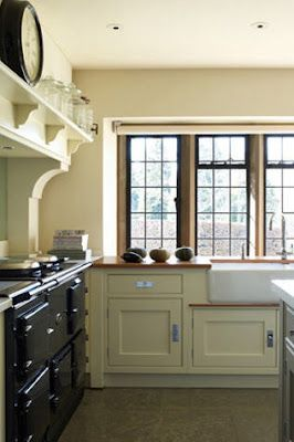 English cottage range mantel & I love the windows
