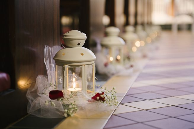 Church aisle decoration lanterns http://goodbyemiss.com/wedding/a-castle-leslie-wedding-from-photography-by-brideen
