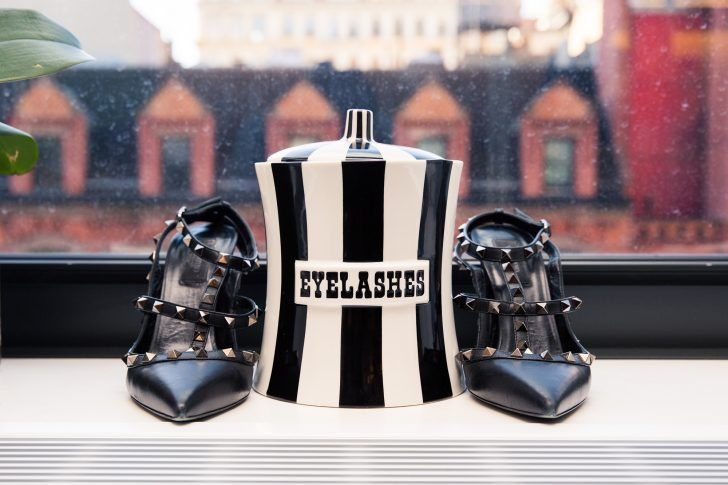 IMG's Senior Vice President Talks Fashion Week: Pointy Toe Strappy Heels with Studs and Black and White Striped Jar | coveteur.com