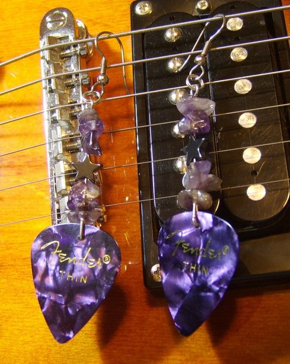 "Release your inner rock star! These musically inspired earrings measure approximately 3 1/4"". Featuring hematite stars, ""rockin"" semi-precious stones, and guitar picks they are a number one hit for any music lover! https://www.etsy.com/listing/67022754/amethyst-rock-star-earrings"