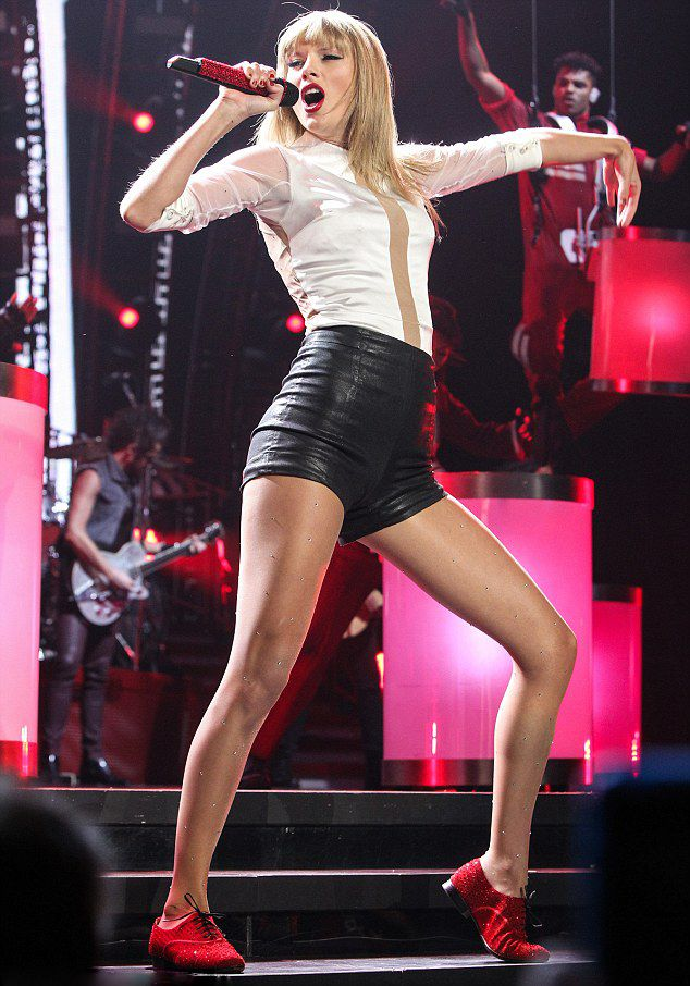 They bring the bling! Taylor Swift duets on stage with Jennifer Lopez as they…