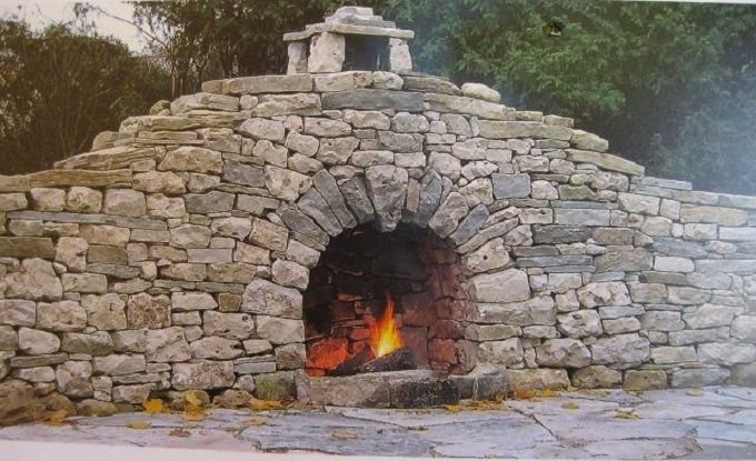 stone wall with fireplace:Incorporate a fireplace into your stone wall. Canadian waller Stephen Niven won a prize in 2009 with this dry stone fireplace. wallswithoutmortar.blogspot.com