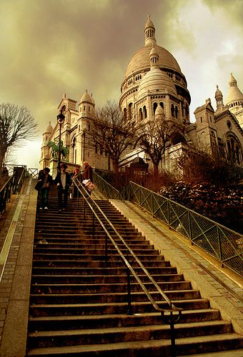 Architecture Research - Basilique du Sacré-Cœur, Montmartre, Paris. I like the low angle used to look up the stairs and then at the Sacré-Cœur and this makes it look far away and this makes it appear superior.