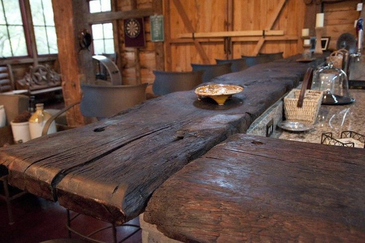 Chunky bar top made with reclaimed barn floor boards.