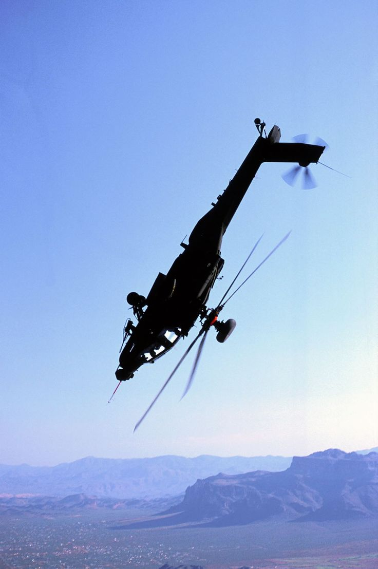 AH 64 Apache doing a flip, which is no easy task for a helicopter. When they are flying normally the blades bend skyward, well upside the blades are still facing skyward. So it just chops its own rear end off and spins out.