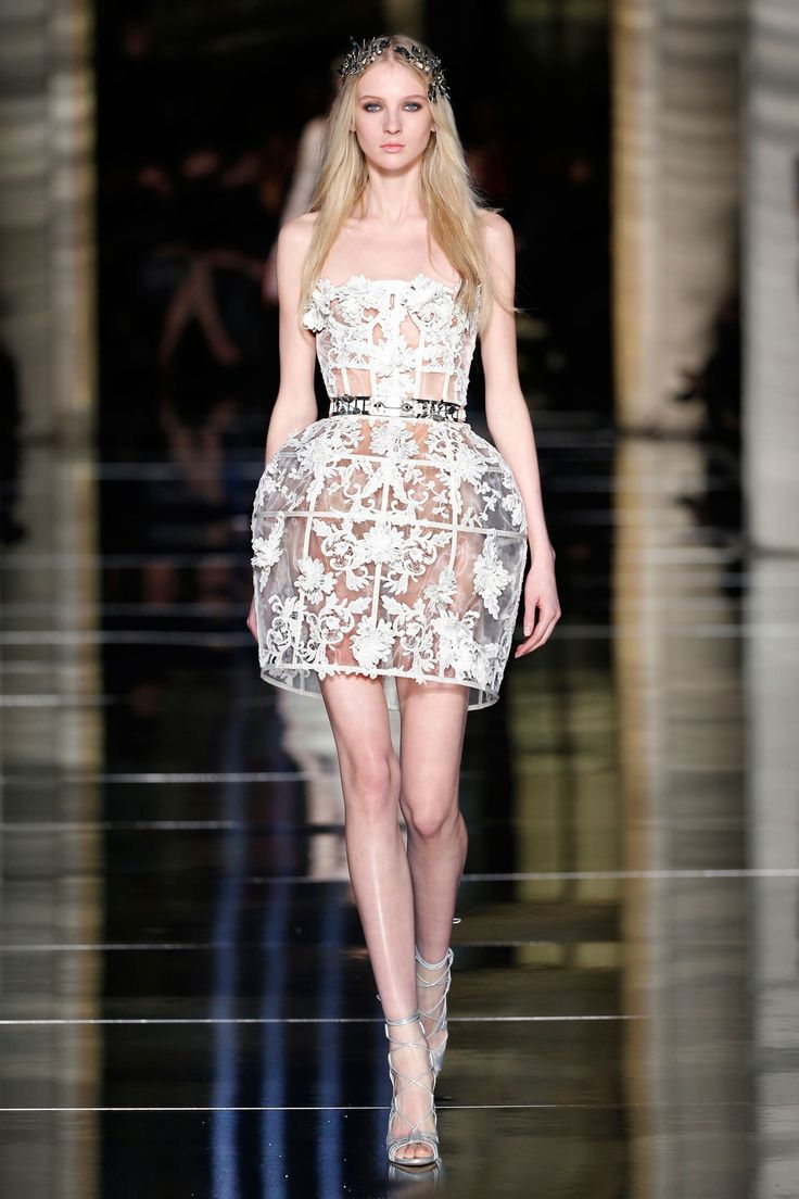 Couture Spring 2015 LOOK 01 Strapless structured white cage dress in silk tulle, embroidered with floral 3D guipure motifs