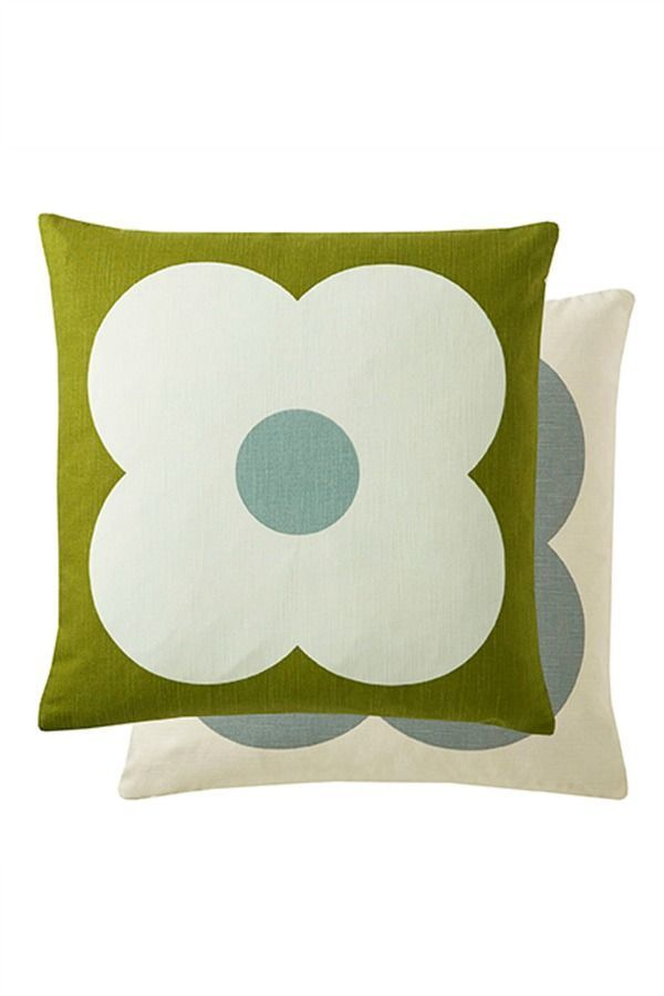 A modern-retro statement Orla Kiely cushion featuring a graphic flower head. Shown here in blue, green and white, it is completely reversible, buy two to show both sides together!