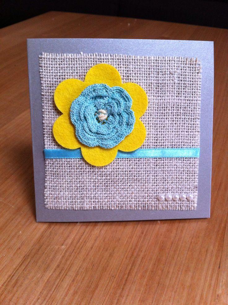 Crochet flower on card.