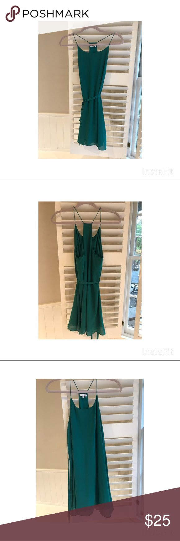 Green Dress Deep sea green. Ties around the waist for a more form fitting fit.  Has slip underneath. Perfect for date night or girls night out! It is on the shorter side - I wore flats with it. Worn once! Naked Zebra Dresses Mini