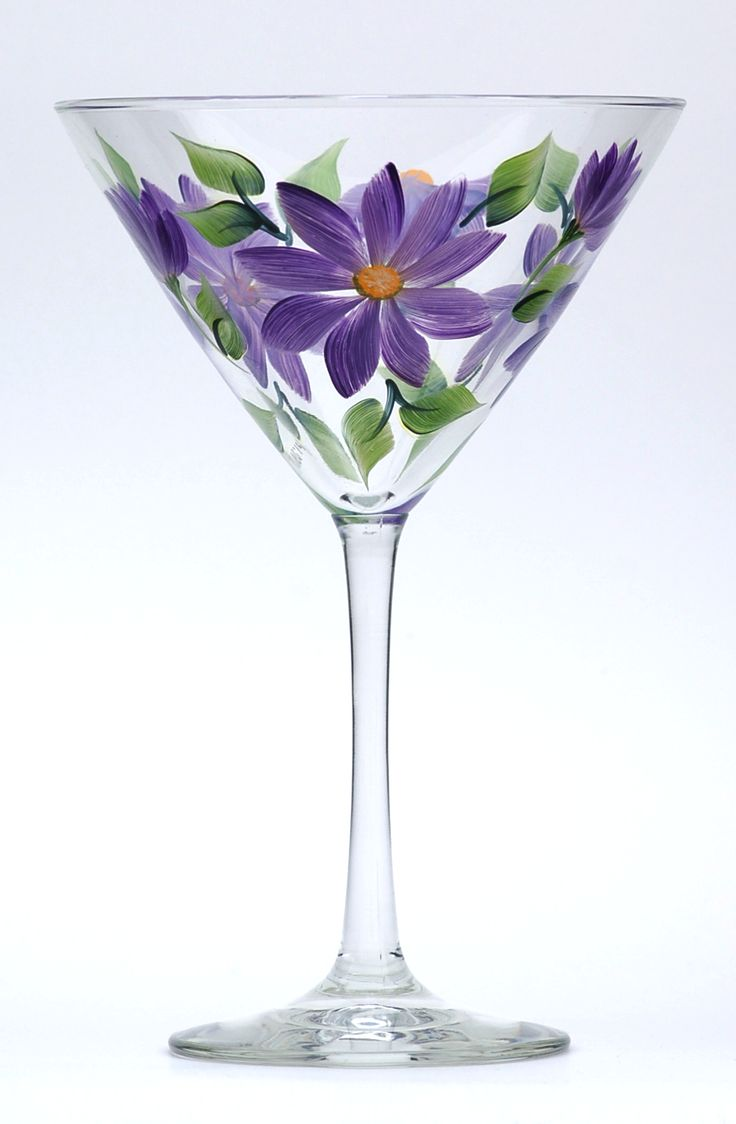 Daisies in shades of brilliant and soft purple highlights, yellow centers and deep green leaves hand-painted encircling a high quality 12 ounce martini glass.
