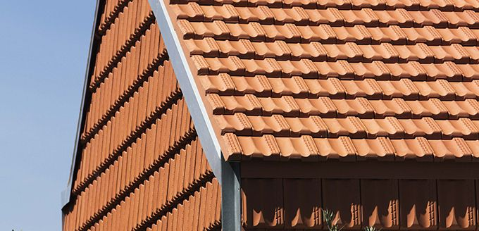 Award Winner - A House With Tiles On It by Welsh + Major Architects featuring Monier Marseille terracotta roof tiles.