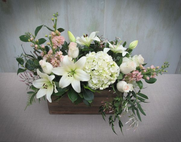 Blush pink and ivory flowers in a wood box lilies roses