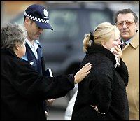 Picture: PAUL HARRIS  Judy Moran is comforted after the execution-style murder of her son, Jason, on Saturday 21 June 2003.