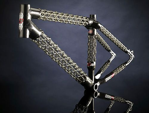 the delta 7 sports arantix mountain bike features an isotruss carbon fiber frame what the hell is that you ask well its a frame made of hand woven carbon