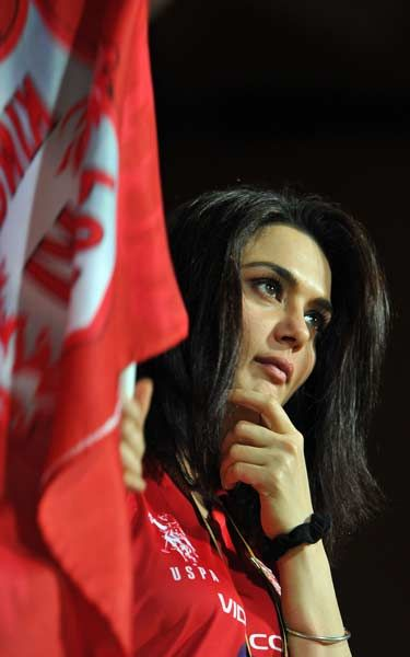 Bollywood actress and co-owner of Kings XI Punjab team, Preity Zinta watches her team playing during the IPL Twenty20 cricket match between Royal Challenger Bangalore and Kings XI Punjab at the M. Chinnaswamy Stadium in Bangalore on May 2, 2012.