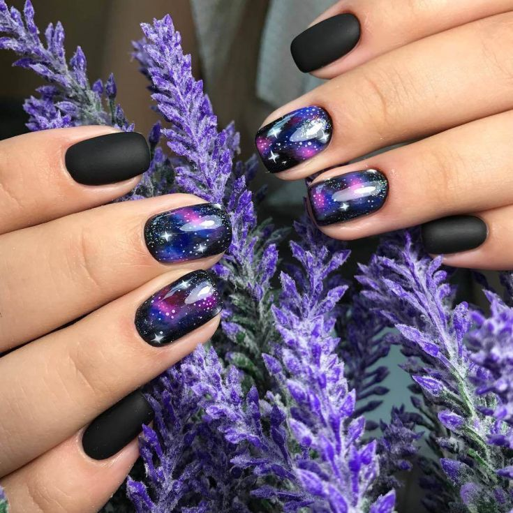 This is the Galactic nail design on the background of a black matte nail polish.