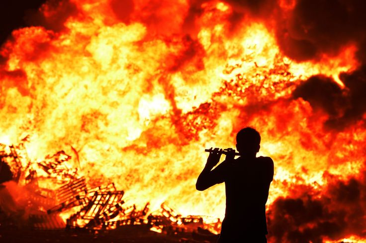 Belfast, Northern Ireland Iain McFarland, an Orange bandsman, plays his flute during the 11th night bonfire at the New Mossley housing estate on July 12Pictures of the week: July 17, 2015