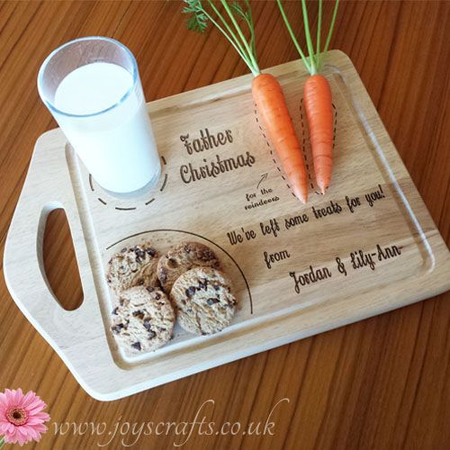Personalised Father Christmas treat wood chopping board. Add some magic to your childs Christmas Eve with this Father Christmas treat board. There is a designated space for his milk or tipple, a snowflake plate for his cookies or mince pie & even an area to place some carrots for the reindeers. We also personalise the board with your childs name/s to make it extra special for the children. Price: £14.95