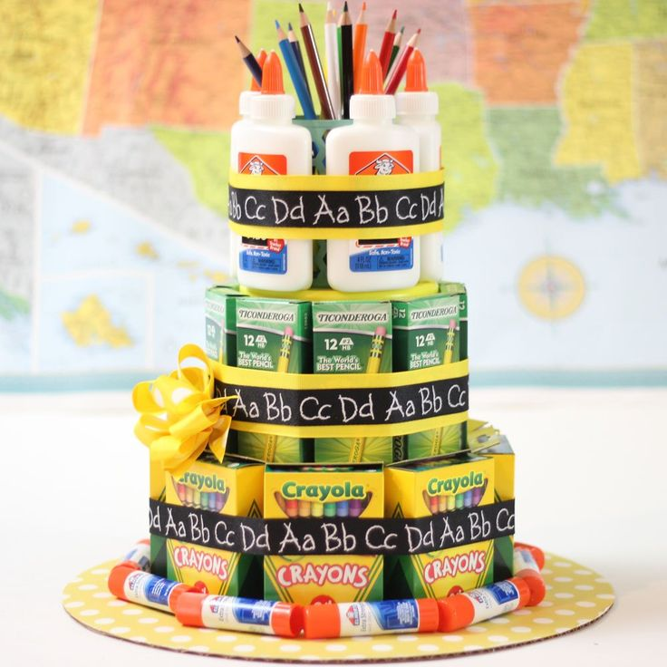 "Here's a teacher appreciation gift that teachers can actually use. It's a ""cake"" made of three tiers of school supplies — boxes of pencils, crayons, glue bottle…"