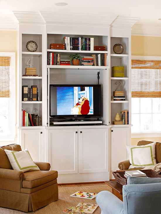 If you don't want the house television to dominate the whole living room, consider incorporating it into a classic wall of built-in shelving.