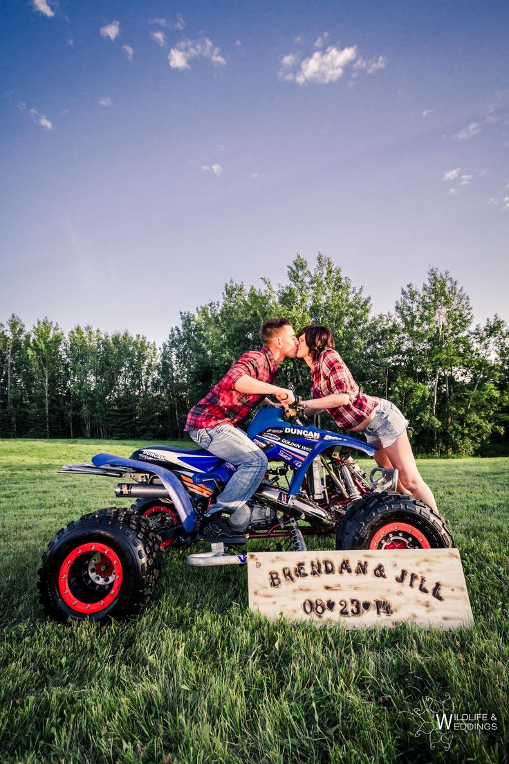 A fun engagement shoot idea! The sign was handmade and I loved using the quad as a prop. Shot by Zokah. Www.Zokah.ca