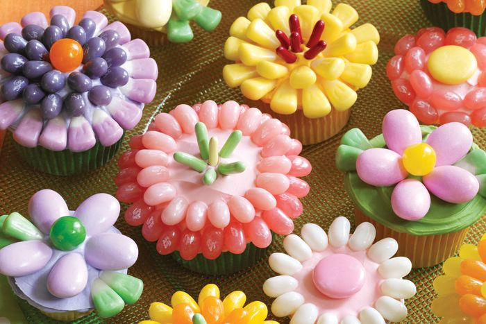 These cupcakes are a breeze! Just use your favorite cupcake recipe and decorate in flower shapes with your favorite Jelly Belly jelly beans and confections. Credit: whatsnewcupcake (Karen Tack and Alan Richardson, authors of Hello, Cupcake!)