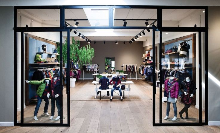 Decoration: Awesome Clothing Store Design Ideas With Natural Oak Floor Also Sliding Glass Doors With Black Metal Frames In Addition To Extemded Lighting Rails: Attractive Wood Flooring Ideas