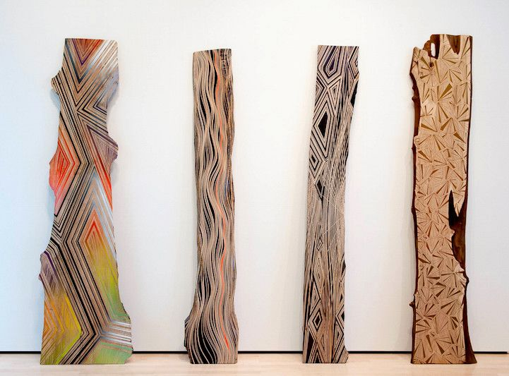 Jason Middlebrook paints geometric shapes on found wood to illustrate the mark man leaves on nature!