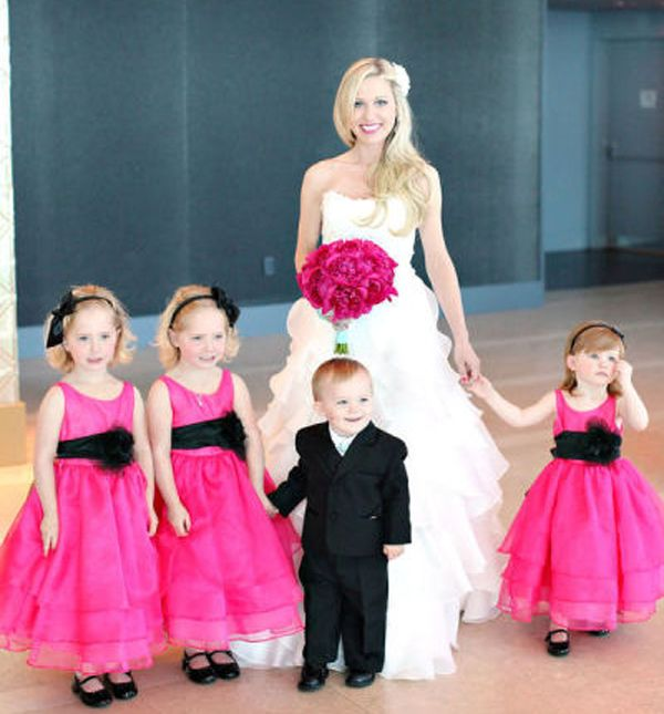 Fuchsia bride bouquet and flower girl dresses with black accents.  So pretty!!