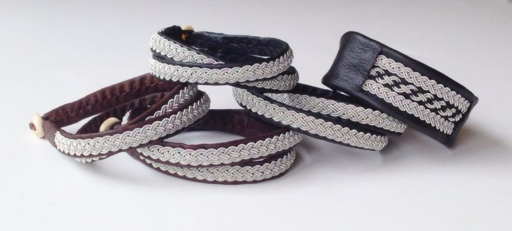 Sami bracelets, pewter/silver threads weaved on reindeer leather, double wraps and single 2.5cm wide. Shed antler horn buttons.