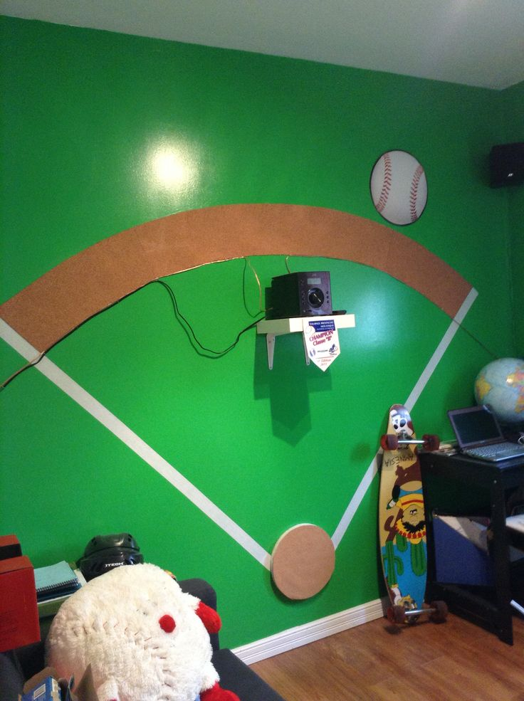 """My son's """"office"""". We recreated a baseball field by painting a green wall and sticking white tape and some cork (for the sand)."""